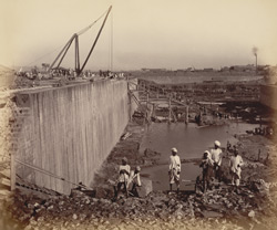 South wall of north jetty, partly coped and one bollard fixed. Excavation of bay nearly complete [Victoria Dock construction, Bombay].